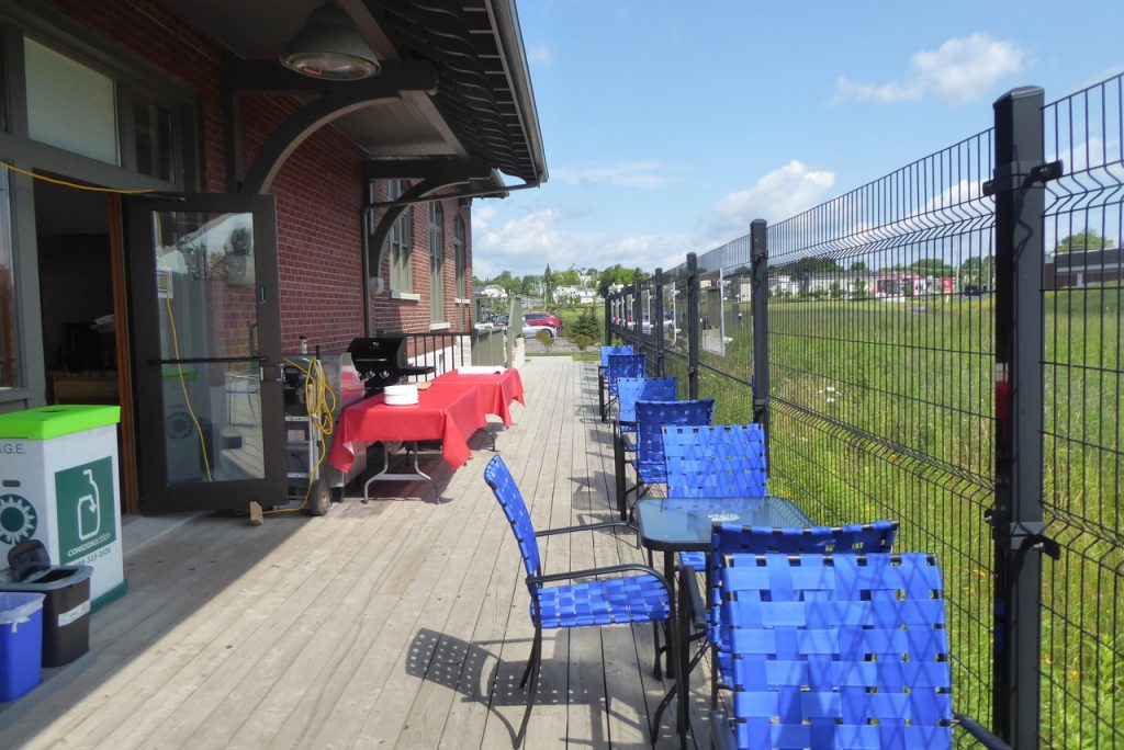 outdoor cafe by tracks